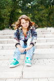 Girl sitting on stairs Royalty Free Stock Photo