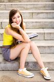Girl sitting on stairs Stock Photos