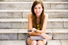 Girl sitting on stairs Stock Photography