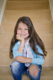 Girl sitting on the stairs. Beautiful girl sitting on the stairs Royalty Free Stock Images