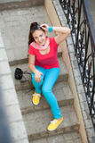 Girl sitting on the stairs Royalty Free Stock Photo