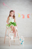 Girl sitting on the stairs with tulips Royalty Free Stock Photography