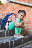 Girl sitting on steps at corridor in school. Portrait of girl sitting on steps at corridor in school Stock Photography