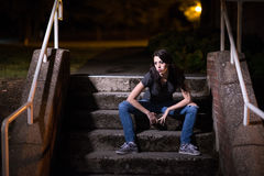 Girl Sitting on Steps at Night Royalty Free Stock Photography