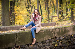 Girl sitting on the stone. Girl sitting on the concrete stone in the Park Royalty Free Stock Image