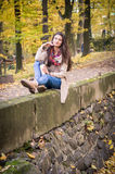 Girl sitting on the stone. Girl sitting on the concrete stone in the Park Royalty Free Stock Photo