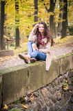 Girl sitting on the stone. Girl sitting on the concrete stone in the Park Stock Photos