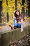 Girl sitting on the stone. Girl sitting on the concrete stone in the Park Stock Photography
