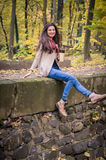 Girl sitting on the stone. Girl sitting on the concrete stone in the Park Stock Images
