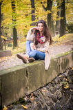 Girl sitting on the stone. Girl sitting on the concrete stone in the Park Royalty Free Stock Photos
