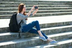 Girl sitting on stone steps 06 Royalty Free Stock Photography