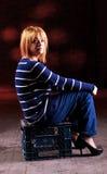 Girl sitting on the stool Stock Photo