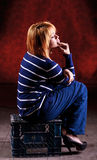 Girl sitting on the stool Stock Photography