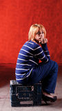 Girl sitting on the stool Royalty Free Stock Photography