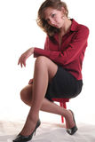 He girl sitting on stool Stock Photography
