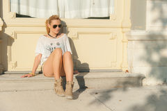Girl Sitting on a Street Stock Image