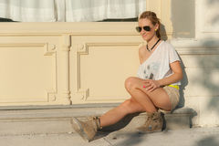 Girl Sitting on a Street Royalty Free Stock Photography