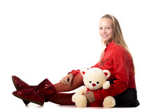 Girl sitting with stuffed animal Royalty Free Stock Photos