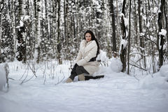 Girl sitting on a stump Royalty Free Stock Image