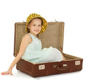 The girl sitting in suitcase Stock Image