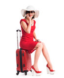Girl sitting on a suitcase Stock Image