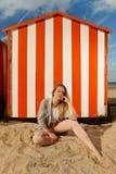 Girl sitting sun sand hut, De Panne, Belgium royalty free stock photos