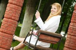 Girl sitting on swing Stock Photography