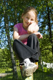 Girl sitting on swing. And smiling Royalty Free Stock Photos