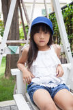Girl sitting on a swing Stock Images