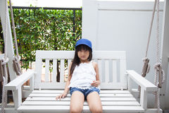 Girl sitting on a swing Royalty Free Stock Image