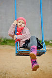 Girl sitting on swing Stock Photography