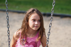 Girl sitting on a swing Royalty Free Stock Images