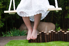 Girl sitting on swing Royalty Free Stock Photos
