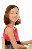 The girl sitting at the table Royalty Free Stock Images