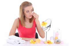 Girl sitting at table with make up accessories and mirror Royalty Free Stock Image