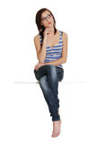 Girl  is sitting and thinking, looking up. Royalty Free Stock Photo