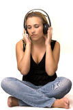 Girl sitting to feel the sound through headphones. Sentiment expressed in the sound transmitted by the music Royalty Free Stock Photos