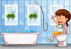 Girl sitting on toilet in bathroom Stock Photos