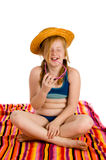 Girl sitting on a towel Royalty Free Stock Image