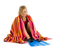Girl sitting with a towel and her flippers Royalty Free Stock Photography
