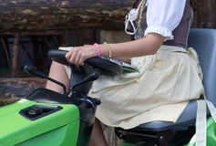 Girl sitting on the tractor Stock Photo