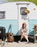 Girl Sitting on a Trailer Step Stock Photography