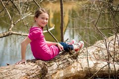 Girl sitting on a tree Royalty Free Stock Photos