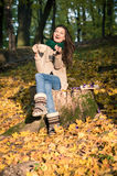 Girl sitting on tree stump Royalty Free Stock Photos