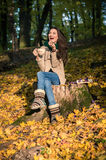 Girl sitting on tree stump Royalty Free Stock Images