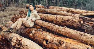 Girl sitting on tree trunk Royalty Free Stock Images
