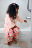 Girl sitting on tub Stock Images