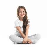 Girl sitting turkish. Portrait of small girl sitting turkish isolated on white background Stock Photography