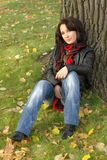 Girl sitting under the tree Royalty Free Stock Images