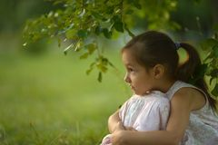 Girl sitting under a tree Stock Image